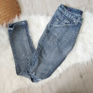 Ankle length distressed skinny jeans